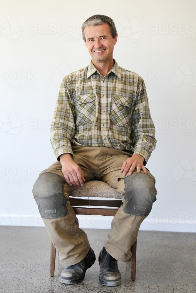 middle-aged man in work clothes - Australian Stock Image