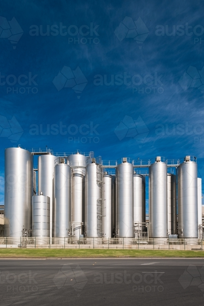 Milk drying towers of large dairy production factory - Australian Stock Image