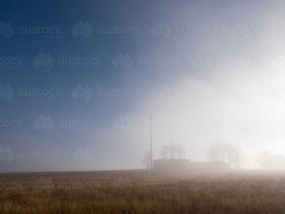 Mist clearing over reservoirs on a ridge - Australian Stock Image