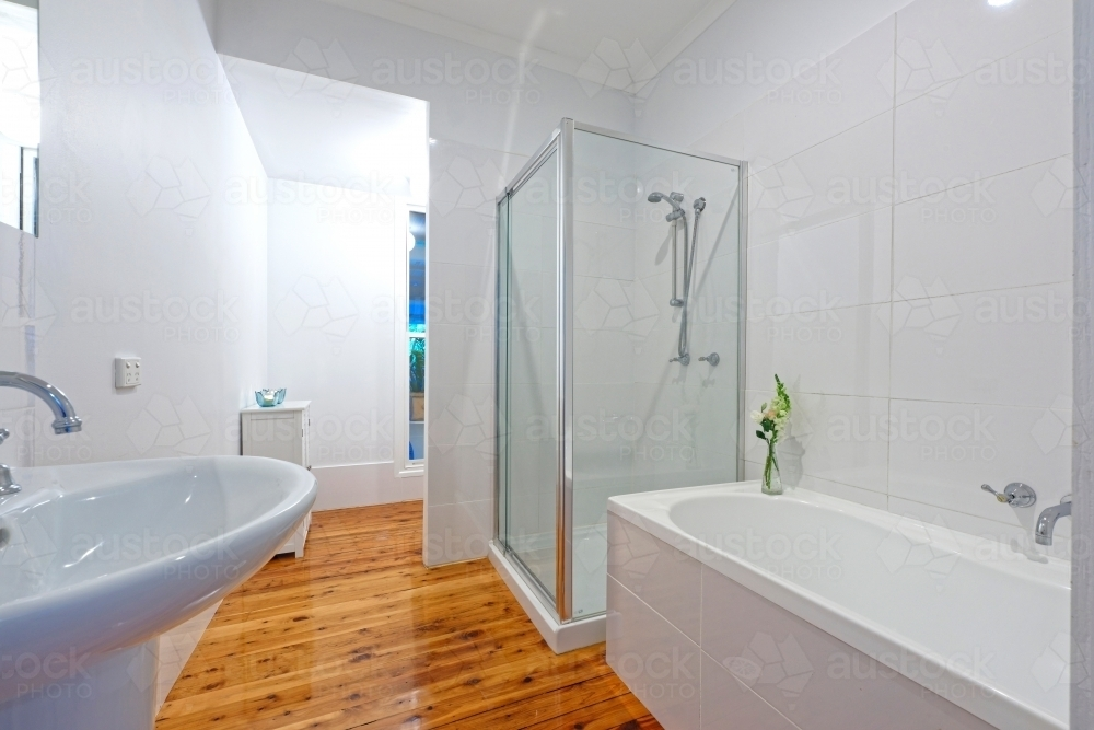 Modern bathroom with shower and polished floors - Australian Stock Image