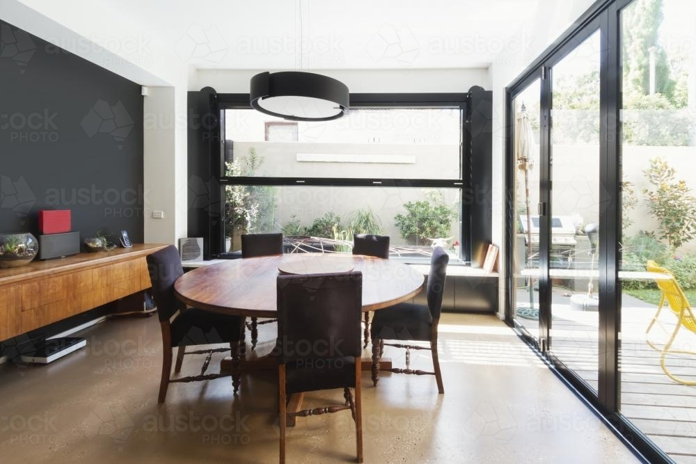 Image Of Modern Dining Room With Concrete Floor And Glass Bi Fold