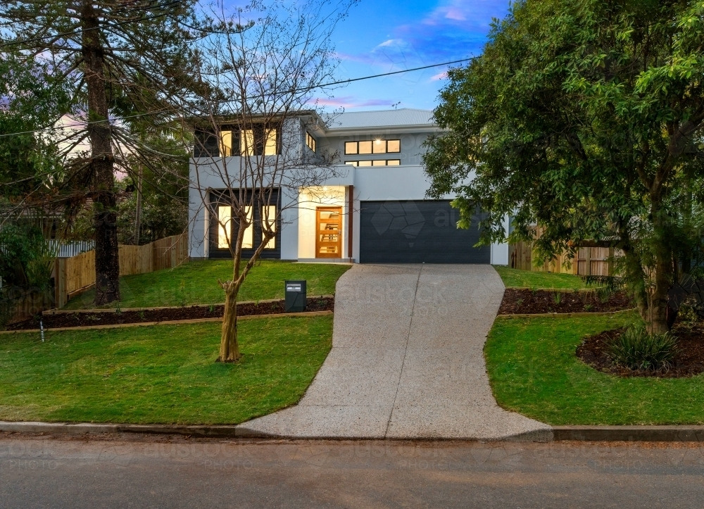 Modern new built double storey home, house exterior twilight - Australian Stock Image