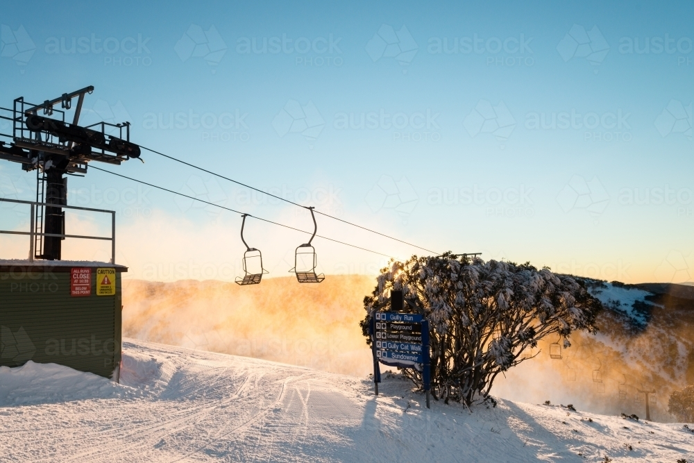 morning light at a ski field, with chairlift - Australian Stock Image