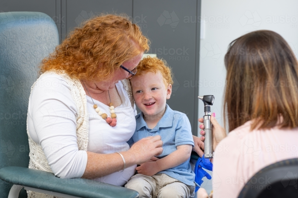 mother and child with doctor in doctor's surgery - Australian Stock Image