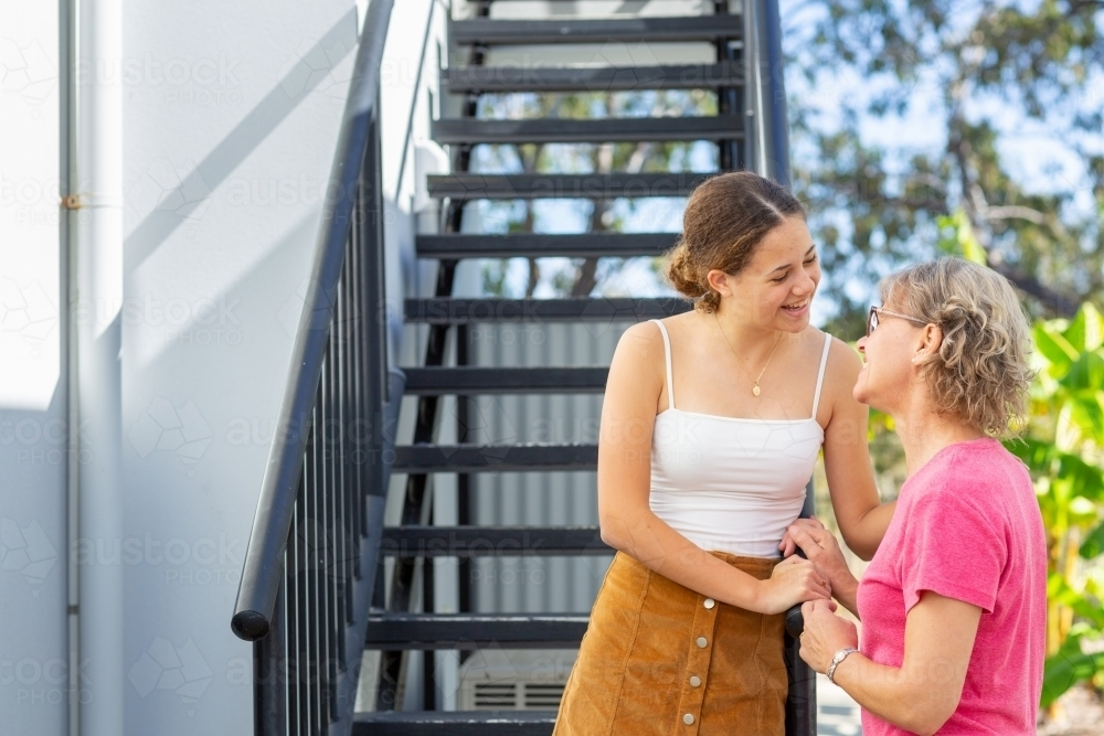 Mother and teen daughter looking at each other - Australian Stock Image