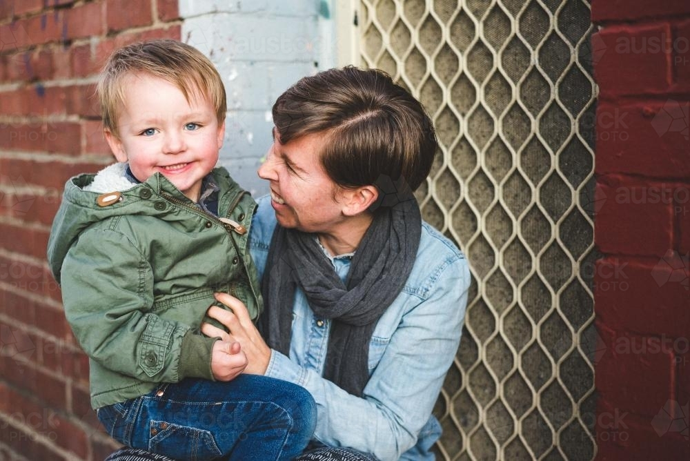 Mum and toddler boy smiling together - Australian Stock Image
