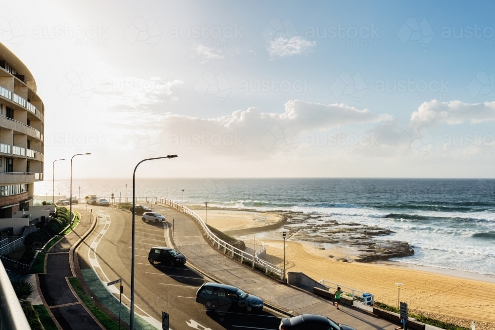 Newcastle beach at sunrise from a balcony - Australian Stock Image
