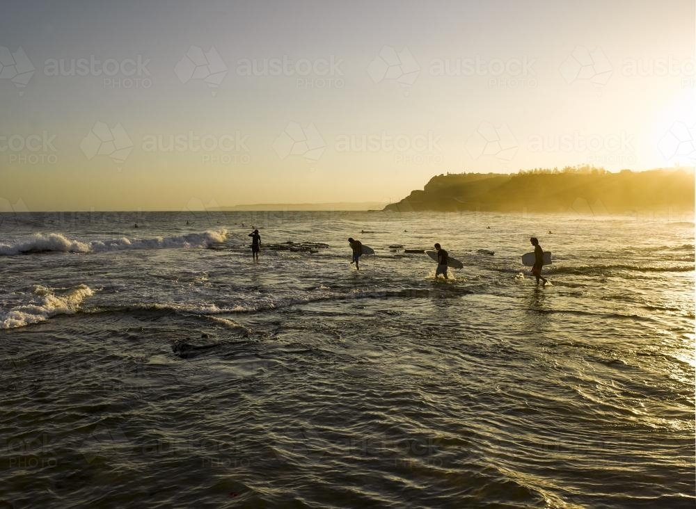 Newcastle Beach surfers - Australian Stock Image