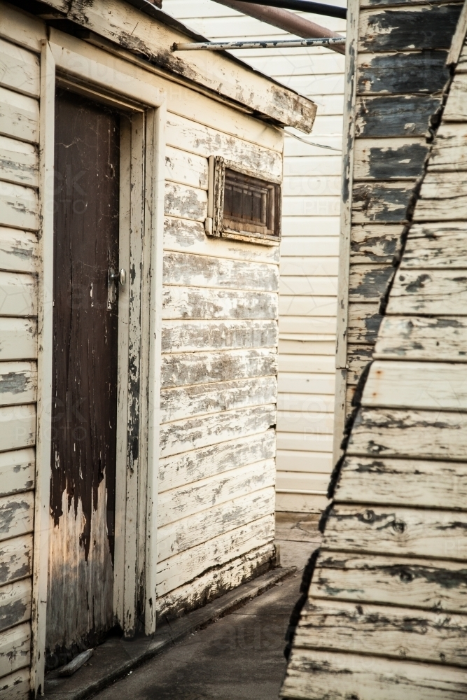 Old buildings on a farm with peeling paint close up - Australian Stock Image