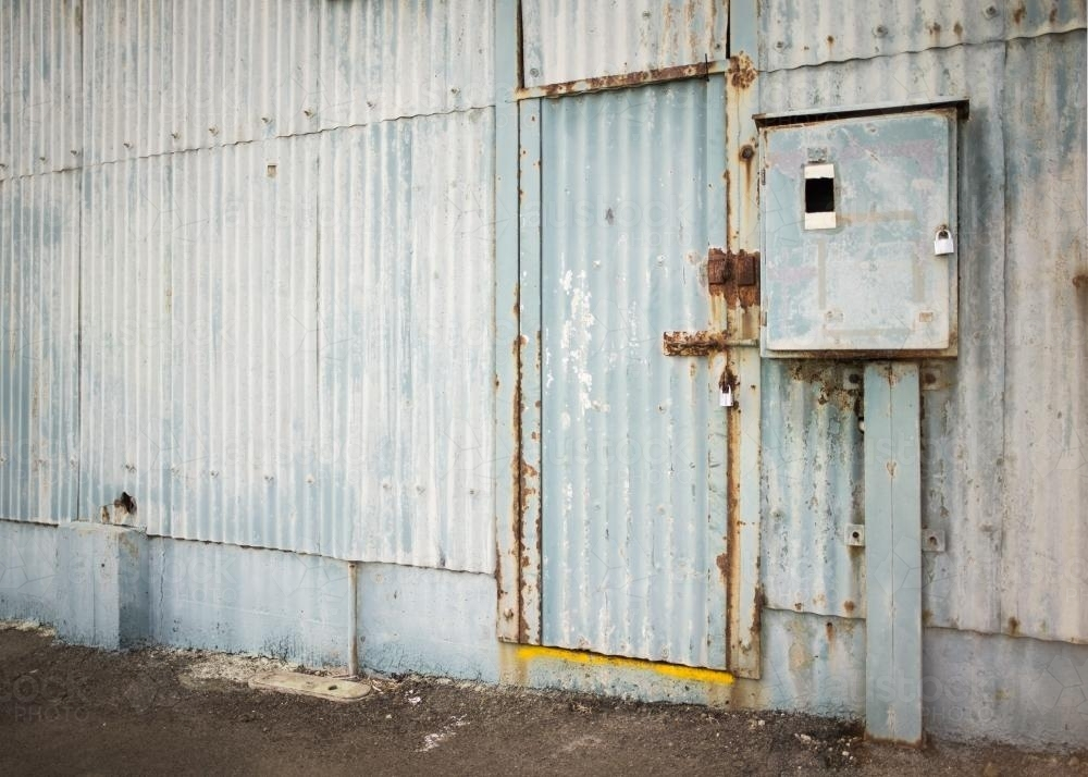 Old faded blue corrugated iron shed and door - Australian Stock Image