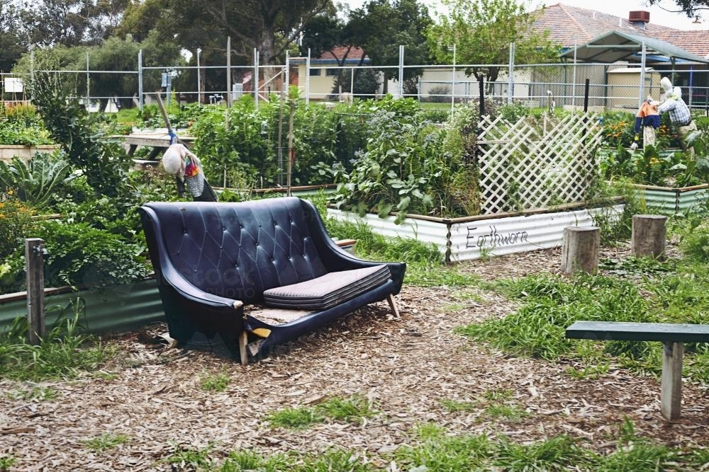 Old lounge in a public self sustainable veggie garden - Australian Stock Image