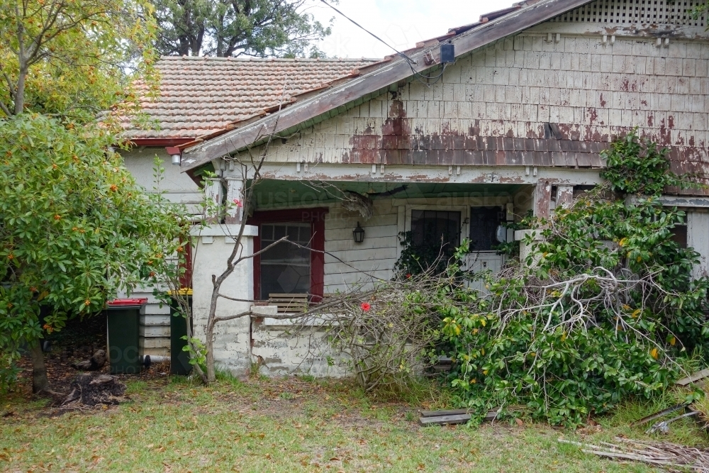 Old weatherboard house collapsing and in disrepair - Australian Stock Image