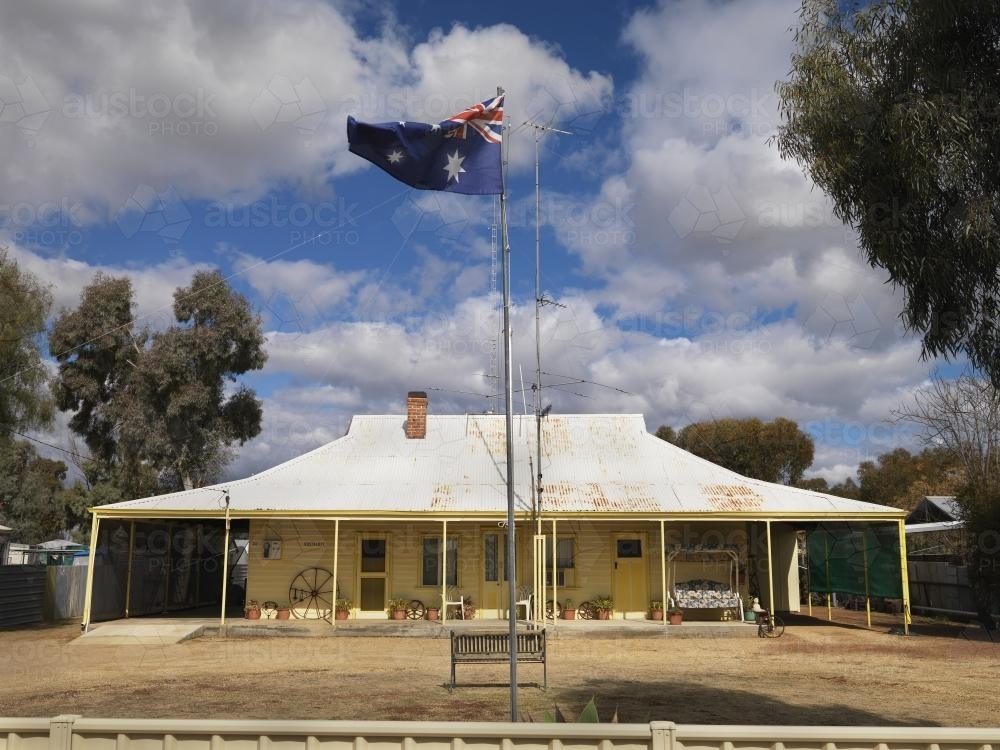 Outback homestead with Australian flag - Australian Stock Image