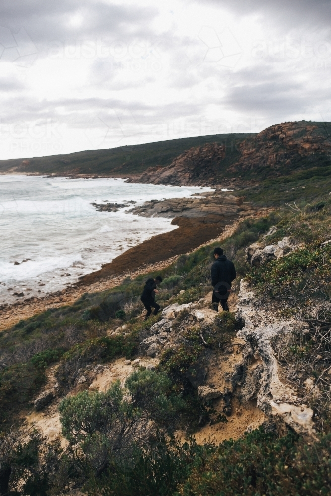 Overcast coastal landscape with two anonymous people - Australian Stock Image