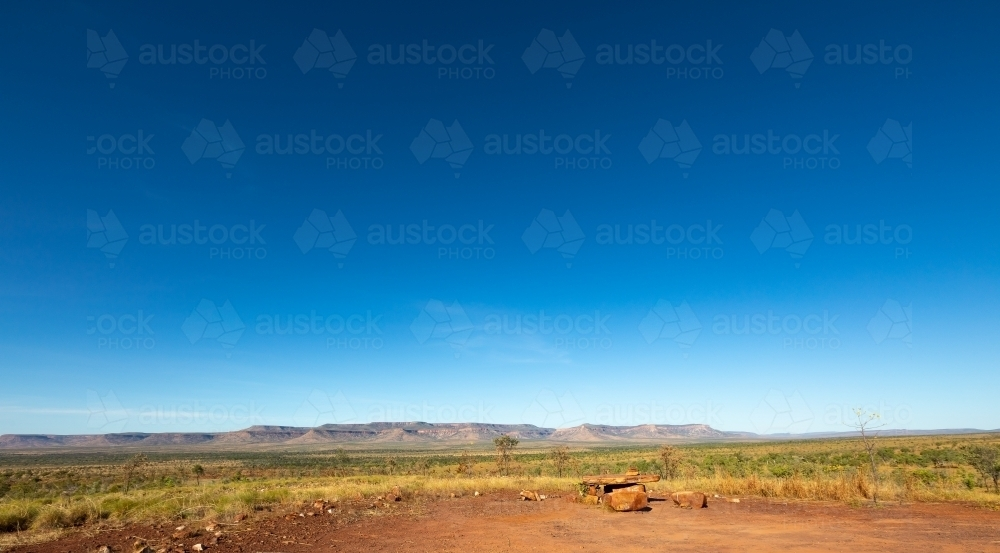 panorama of the vast east Kimberley landscape with Cockburn Range and blue sky - Australian Stock Image