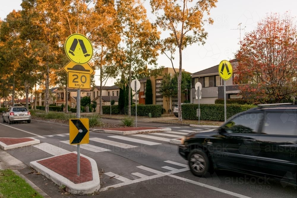 Pedestrian crossing on a speed hump on a suburban Sydney street - Australian Stock Image