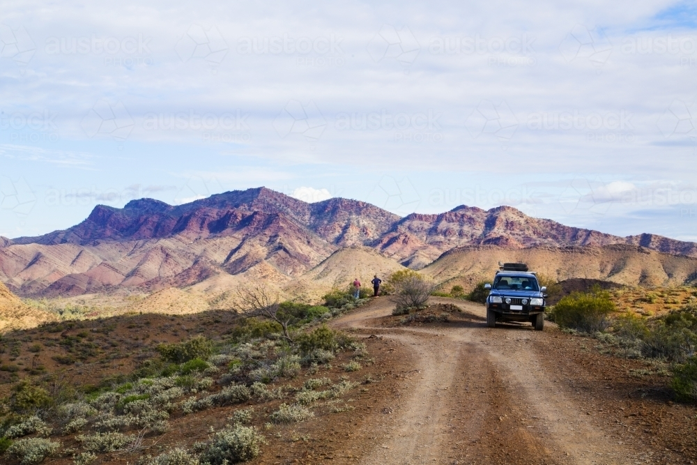 People and four wheel drive at a look out over rugged mountains - Australian Stock Image