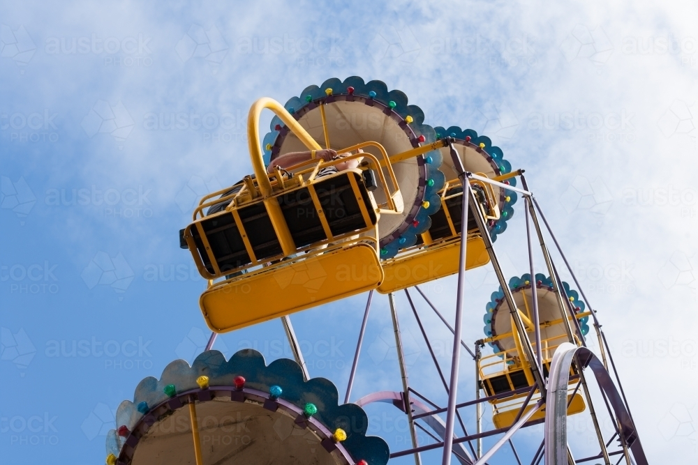 People on a ferris wheel at a city fun park - Australian Stock Image