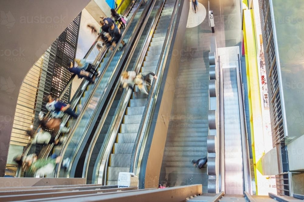 People on escalators in a shopping centre - Australian Stock Image