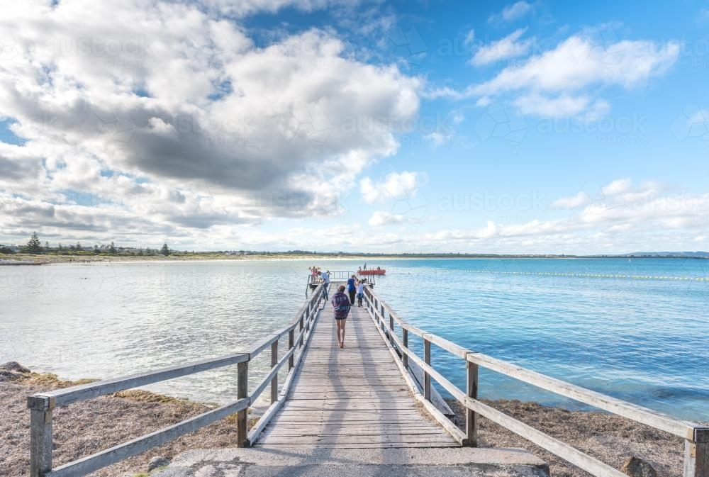 People on jetty by the sea - Australian Stock Image