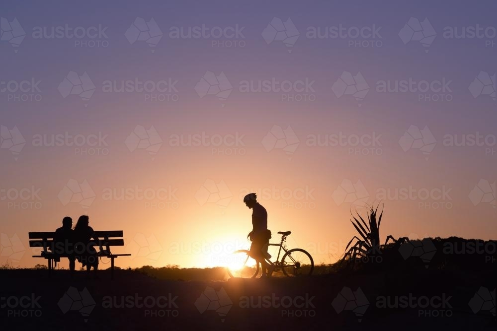 People silhoettes at sunset - Australian Stock Image
