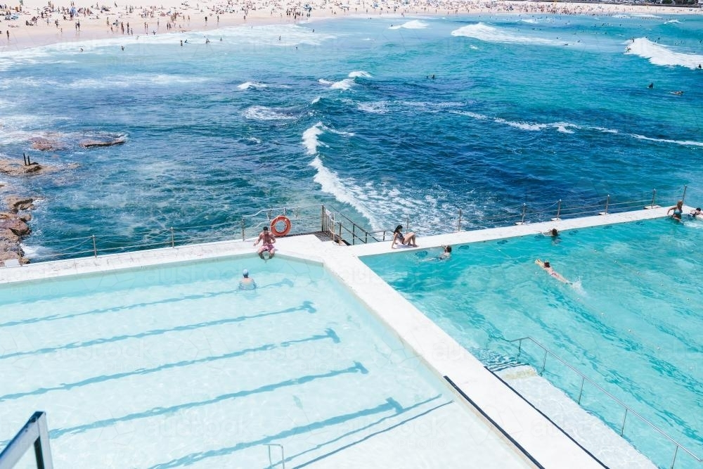 People swimming at Icebergs in Bondi - Australian Stock Image