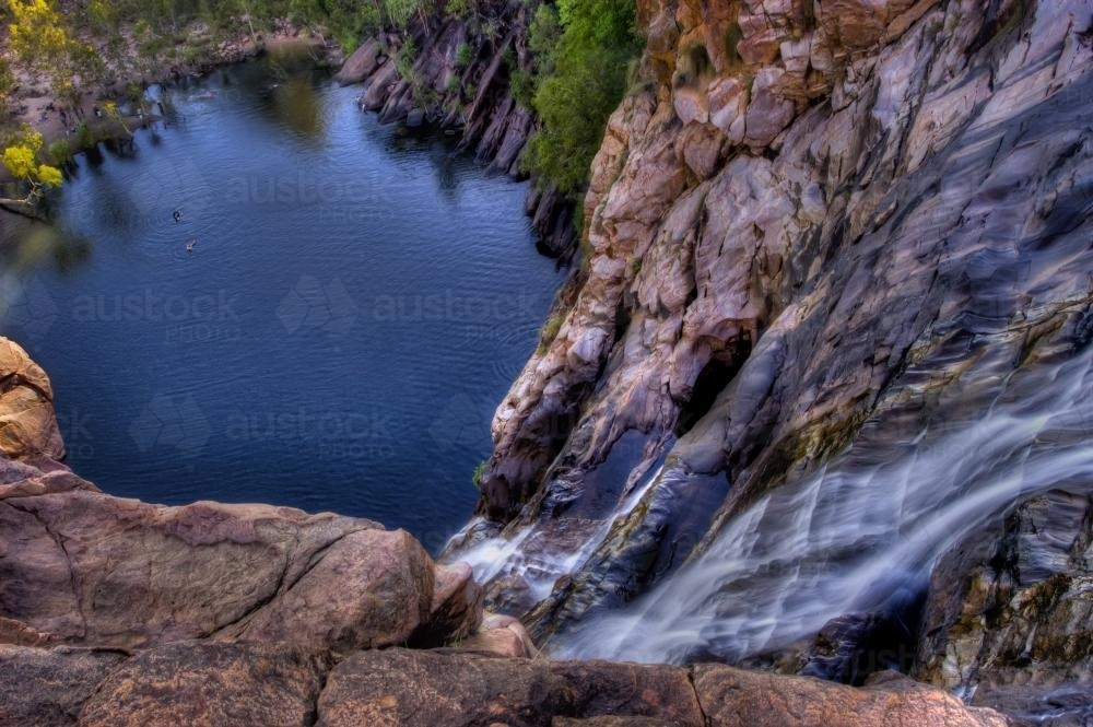 People swimming below Gunlom Falls Kakadu - Australian Stock Image