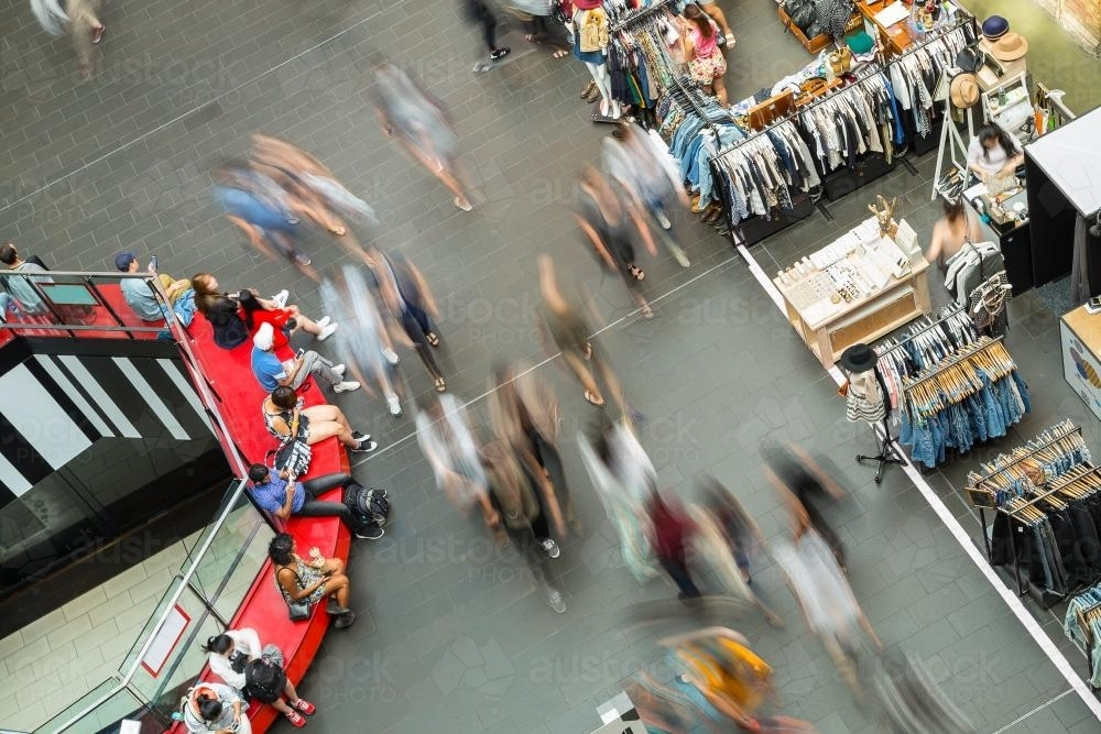 People walking through a busy shopping centre - Australian Stock Image