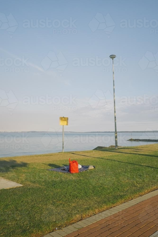 Picnic on the grass looking over the bay - Australian Stock Image