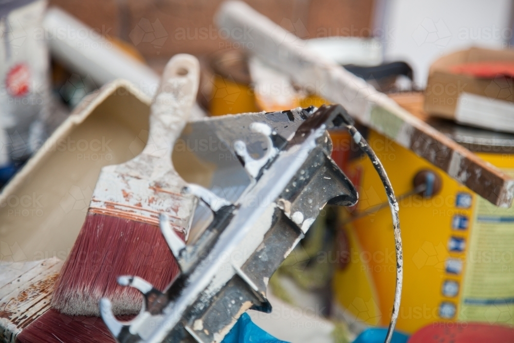 Pile of tradie painters equipment and paintbrush - Australian Stock Image
