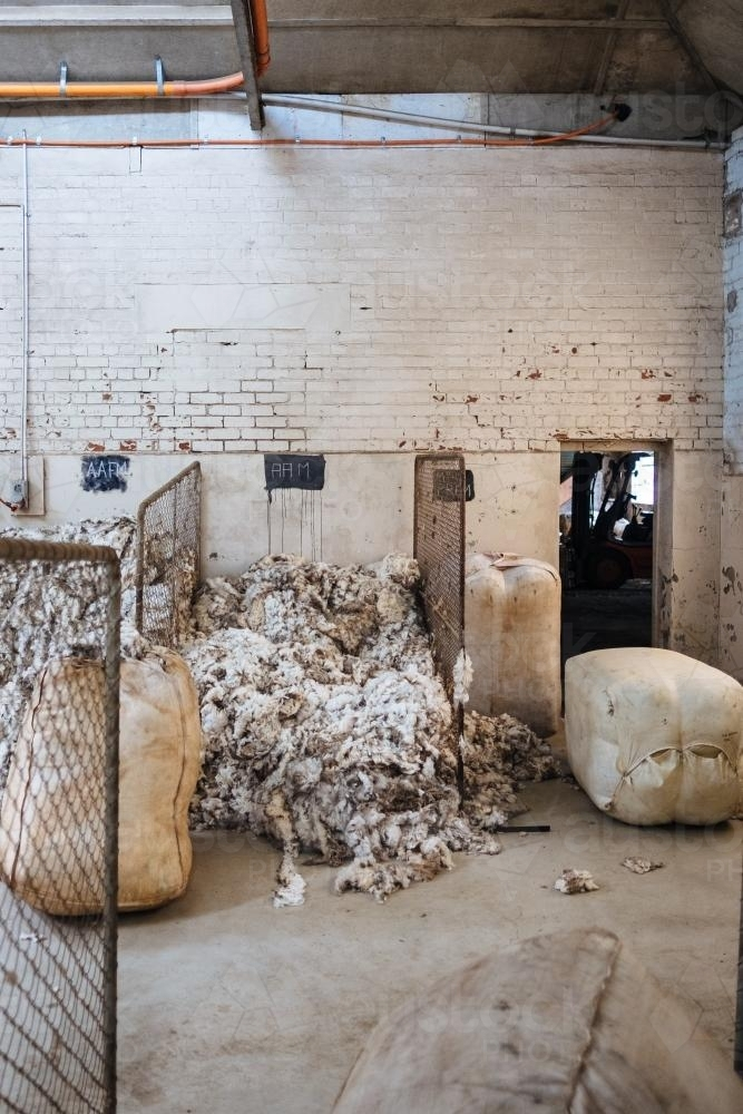 Piled wool in wool grading warehouse - Australian Stock Image