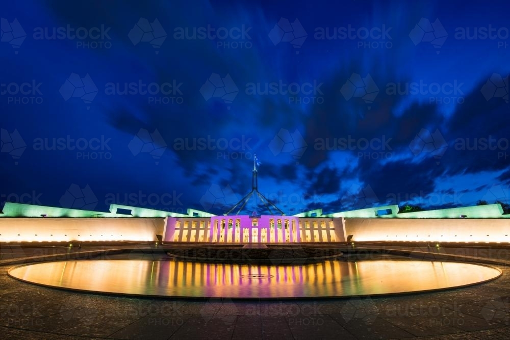 Pool of reflection at night in front of Parliament House Canberra - Australian Stock Image