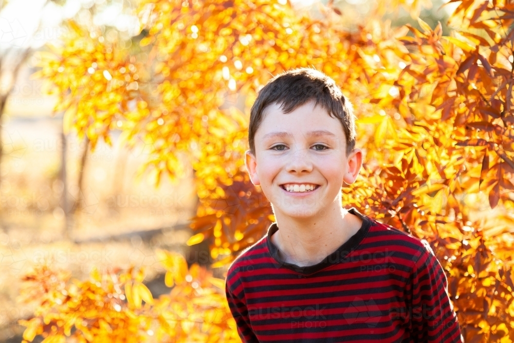 Portrait of a happy ten year old in autumn - Australian Stock Image