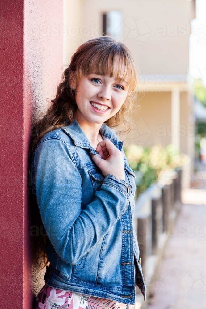 Portrait of a happy young woman in urban setting - Australian Stock Image