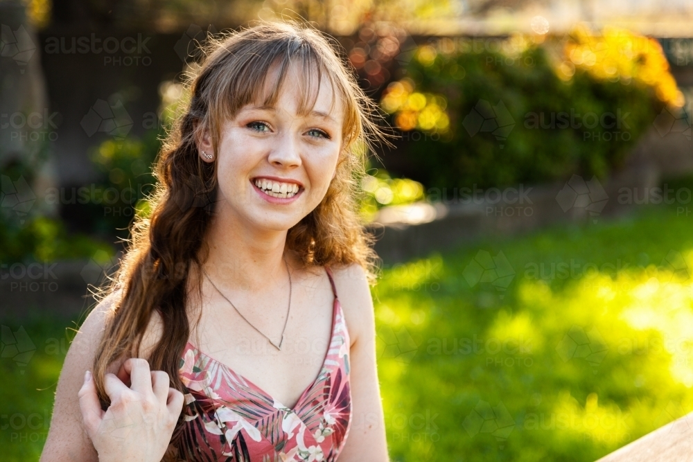 Portrait of a smiling young woman in her late teens - Australian Stock Image