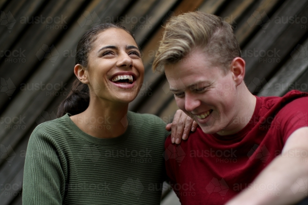 Portrait of happy young mixed race couple - Australian Stock Image