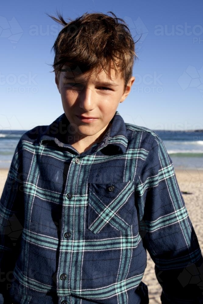 Portrait of young boy at the beach - Australian Stock Image