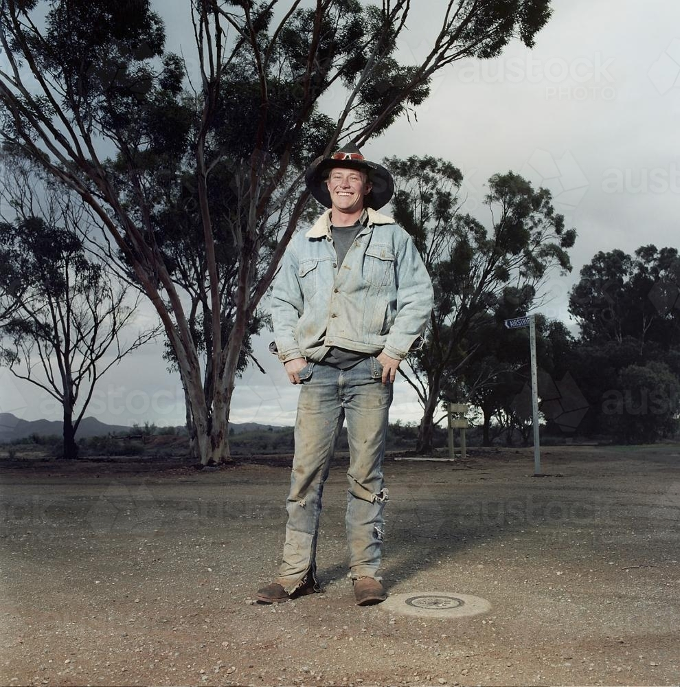 Portrait of young male rural worker standing on street in remote loaction - Australian Stock Image