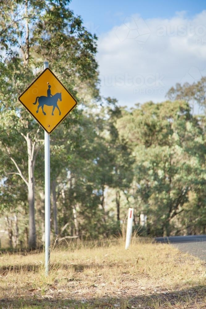 Possible horse and rider ahead sign on country road - Australian Stock Image