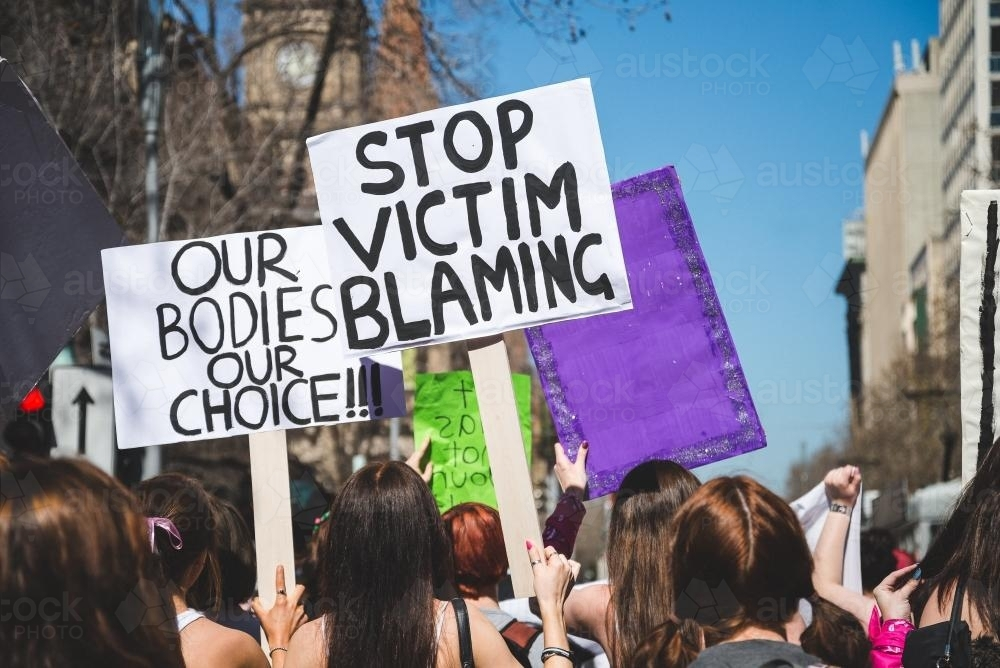 Protesters at a rally in support of sexual assault victims - Australian Stock Image