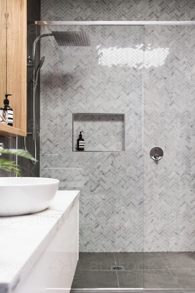 Image Of Rain Shower With Herringbone Marble Feature Tile