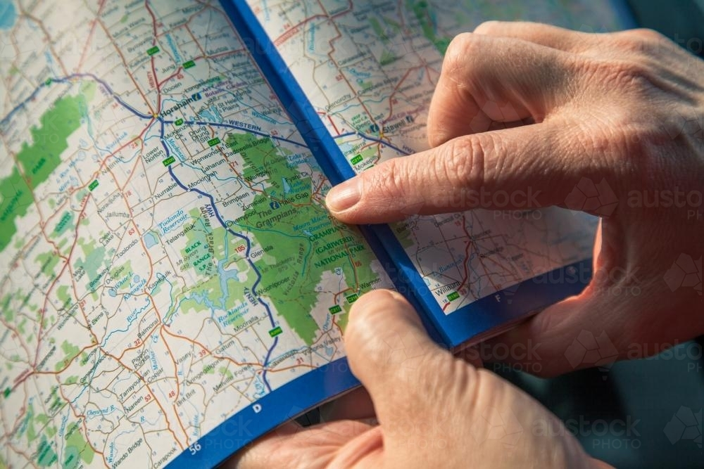 Reading a map. - Australian Stock Image