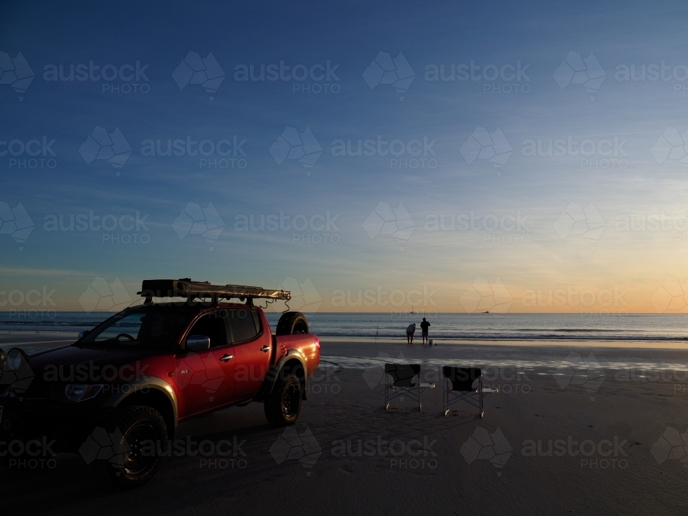 Red 4WD on Cable Beach at Sunset - Australian Stock Image