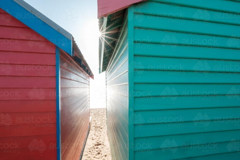 Red and Green Bathing Boxes from Behind - Australian Stock Image