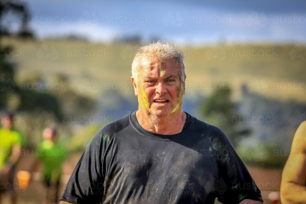Retiree completing fitness course - Australian Stock Image