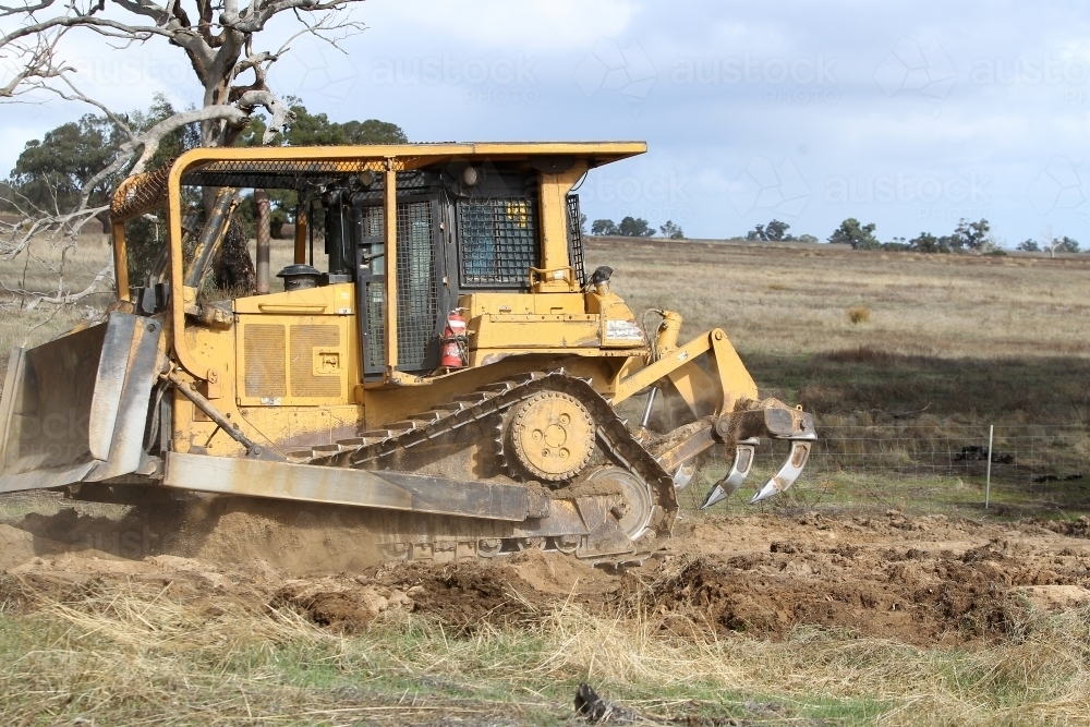 Ripping up rabbit burrows - Australian Stock Image