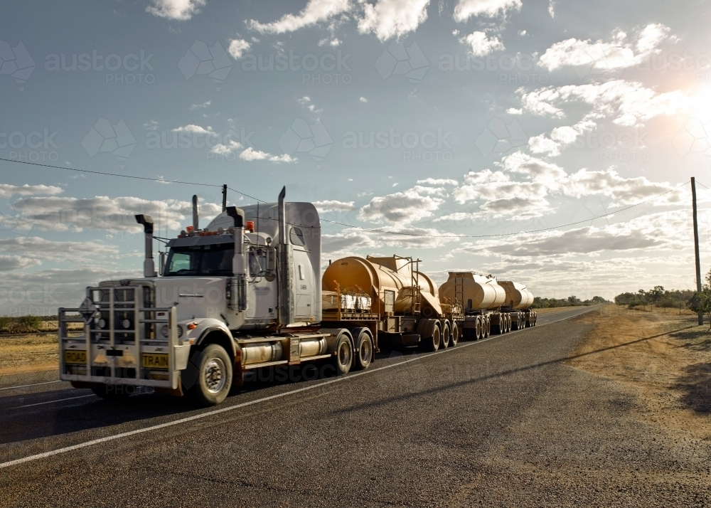 Road Train passing through a country town - Australian Stock Image