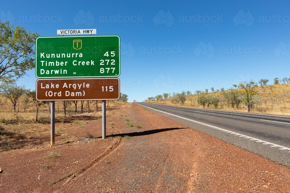 roadside view of road sign near Kununurra on the Victoria Highway - Australian Stock Image