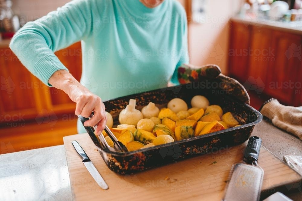 Roast vegetables being served - Australian Stock Image