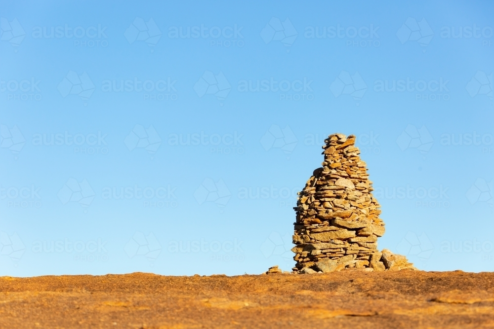 rock cairn atop granite outcrop on wheatbelt way - Australian Stock Image